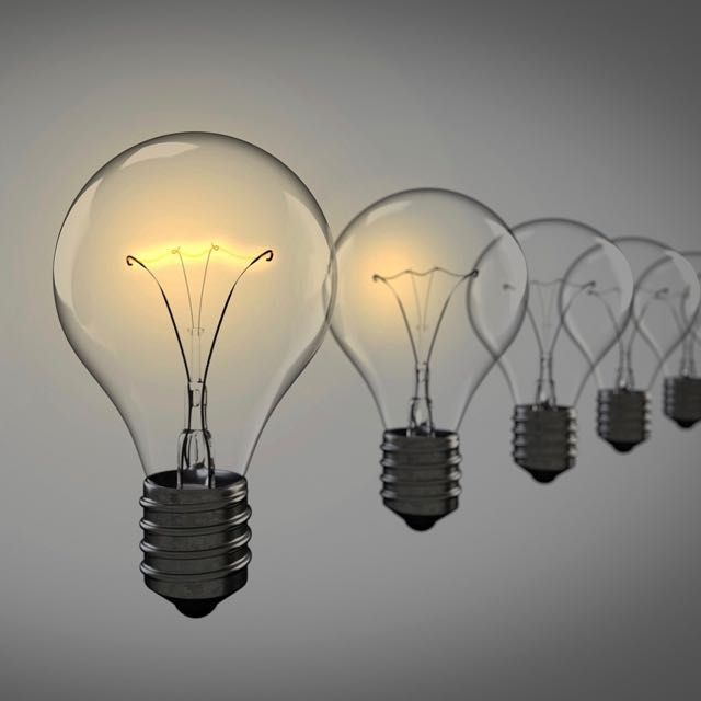 Executive coaching with Tracy Dempsey - photo of receding lightbulbs, front one lit